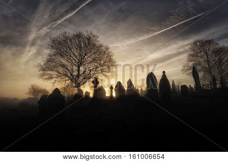 Halloween graveyard A spooky church graveyard on a misty Winter morning