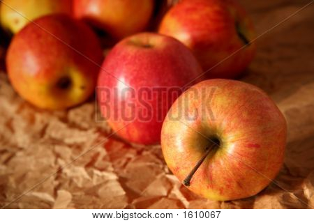 poster of Yellow and red apples on a beige background