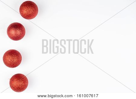Christmas balls isolated on white background. Top view with copy space