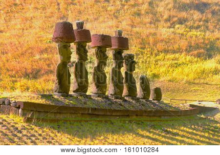 Moai statues wear Pukaos at Anakena Beach on Easter Island in Chile