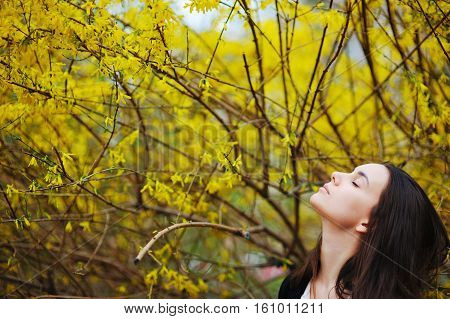 Girl Sniffing Yellow Flowers Breathe Fragrance Of Nature