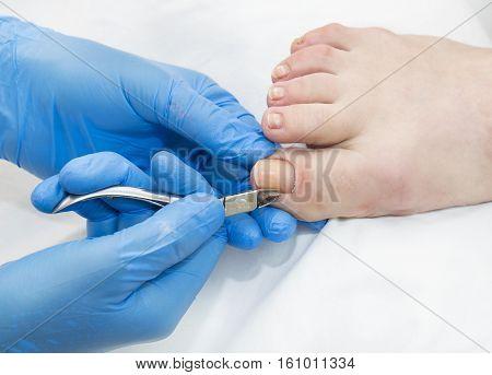 Process of pedicure at beauty salon Job