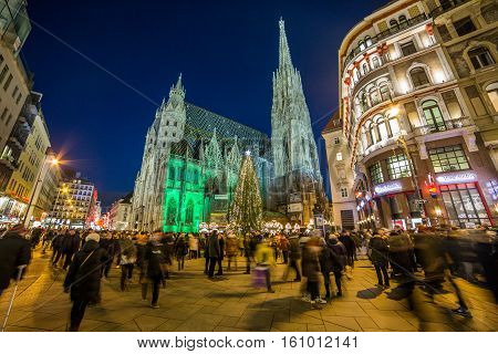 VIENNA AUSTRIA - 2ND DECEMBER 2016: St stephen's cathedral (Stephandsdom) at Christmas. Large amounts of people can be seen.
