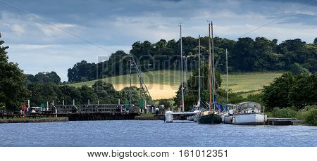 vessels with masted moored in Turf Lock. Exeter. Devon. England