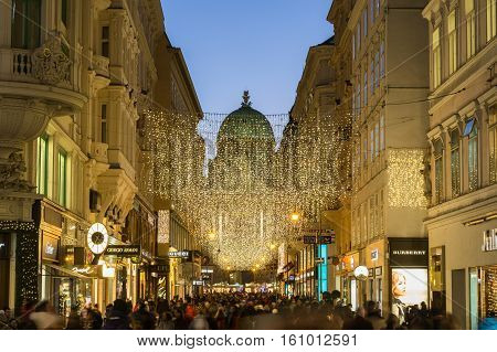 VIENNA AUSTRIA - 2ND DECEMBER 2016: A view along Kohlmarkt in Vienna at Christmas. Lots of people decorations and the outside of shops can be seen.