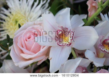 Pink roses and Cymbidium orchids wedding arrangement