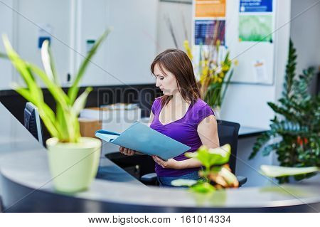 Beautiful Young Receptionist At Work