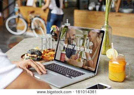 Unrecognizable Man Keeping Hand On Touchpad Of Modern Laptop, Surfing Internet, Checking Newsfeed On