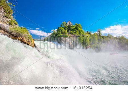 View to Rhine falls (Rheinfalls) the largest plain waterfall in Europe. It is located near Schaffhausen between the cantons of Schaffhausen and Zurich in Switzerland
