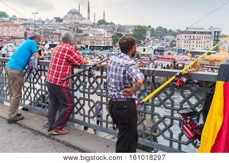 Fishermen Are On Bridge In Istanbul, Turkey