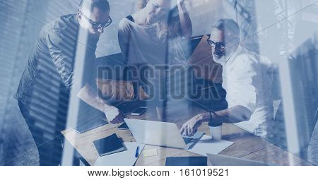 Concept of double exposure.Young business team making great discussion in modern coworking loft.Bearded businessman talking with colleagues about new startup project.Horizontal, blurred background
