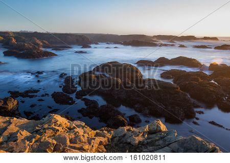 Rocky Shoreline In The Coast Of California