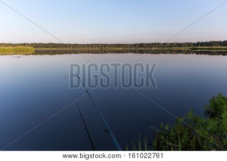 summer evening rod fishing on the lake
