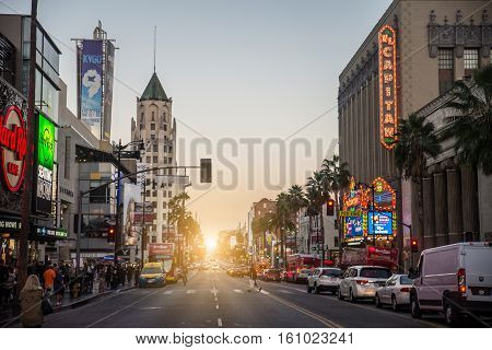 HOLLYWOOD CA - OCTOBER 12 2016: View of Hollywood Boulevard at sunset. In 1958 the Hollywood Walk of Fame was created on this street as a tribute to artists working in the entertainment industry.