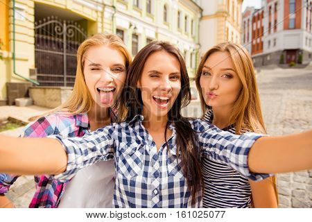 Funny Selfie Of Three Girlfriends Pouting And Showing Tongue