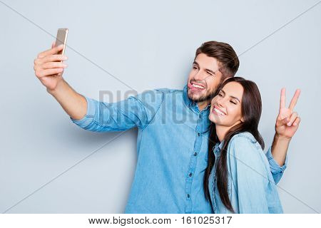 Portrait Of Two Happy Lovers Making Selfie On Smartphone