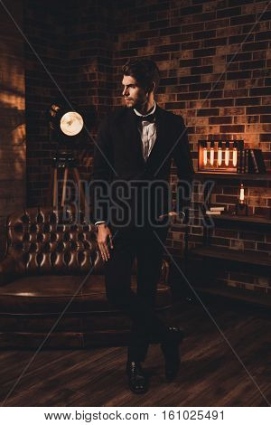 Young Sexy Handsome  Man Dressed In Elegant Black Suit