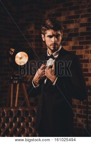 Portrait Of Handsome Stylish Man In Black Suit And Bow-tie