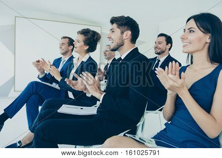 Group Of Business People Applausing At The End Of Financial Seminar