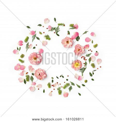 Floral round frame on white background. Flat lay top view. Ornament with rose flowers petals succulent plants green leaves and red berries with space for text.