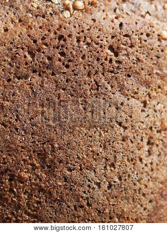 Rye black bread crust texture detail whole grain bread background