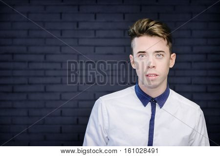 Handsome Young Man Portrait Over Blue Wall Background