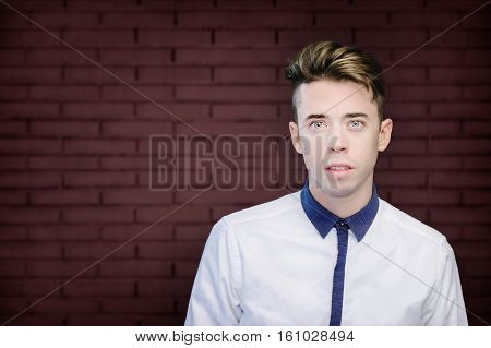 Handsome Young Man Portrait Over Red Wall Background