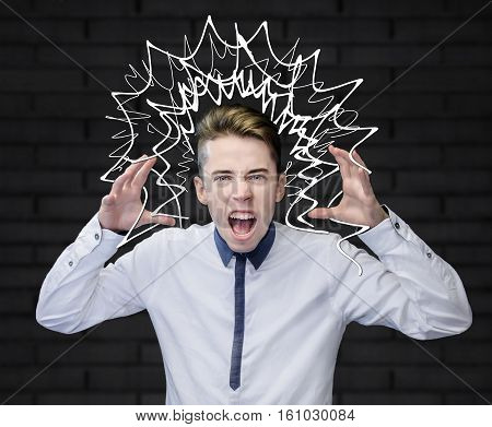 Young man screaming with his arms up