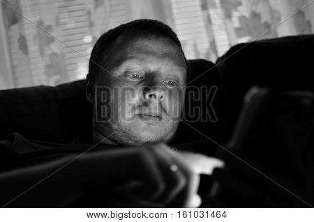 Black And White Image Of Man Using Touch Pad