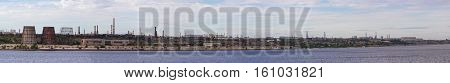 Panoramic view of ironworks located on the river coastline. Industrial landscape.