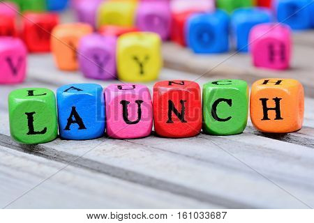 Launch word on grey wooden table closeup