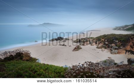 Magical island Fog seascape Pessegueiro, Sines Portugal Alenteijo