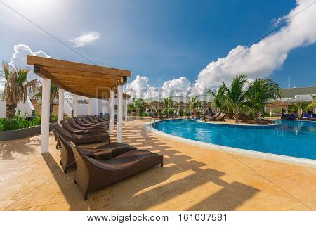 Cayo Guillermo island, Iberostar Playa Pilar hotel, Cuba, June 28, 2016, nice beautiful inviting view of a curved wide open comfortable swimming pool with people relaxing and enjoying their time