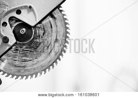An industrial circular saw blade in black and white