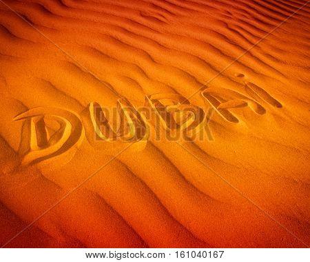 Text in desert sand Dubai