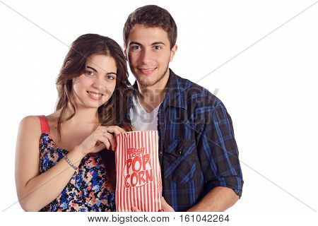 Portrait of a young beautiful couple eating popcorn and watching movies. Isolated white background.