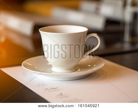 Closeup white cup of coffee break in the meeting room