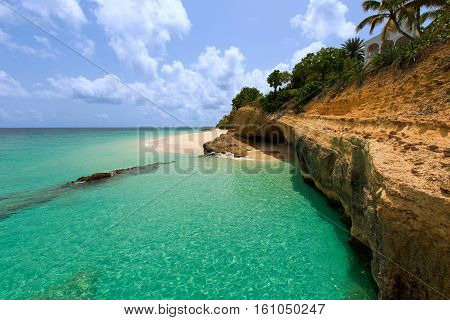 view of rugged rocky coast at anguilla island caribbean with turquoise water and white sand beach
