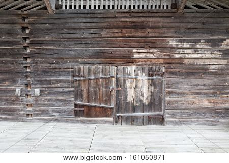Old wooden barn wall and closed door