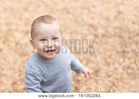 adorable toddler being playful and enjoying time at the playground