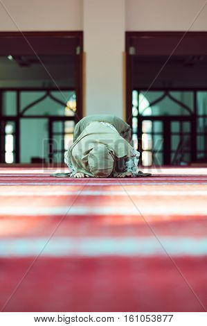 Young beautiful Muslim Woman Praying In Mosque.