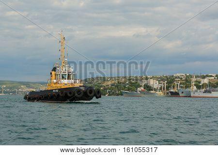 Sevastopol, Russia - June 09, 2016: Raid tug RB-412 in the Bay of Black Sea.