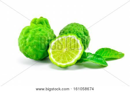 The green kaffir lime, half kaffir lime and leaf of kaffir lime on white background isolate.