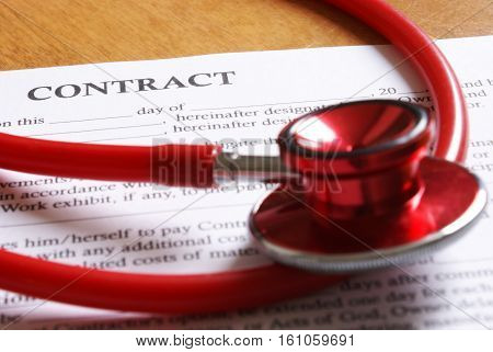 Closeup view of a new contract for medical reason arranged on the desktop.