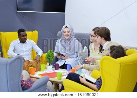 group of young business people, Startup entrepreneurs working on their venture in coworking space