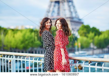 Beautiful Twin Sisters In Front Of The Eiffel Tower