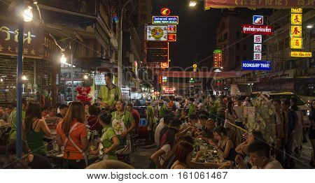 Bangkok Thailand - 31 January 2015 : People come to shopping at bangkok chinatown on Yaowarat RoadThere are many small streets and alleys full of shops and vendors selling all types of goods.