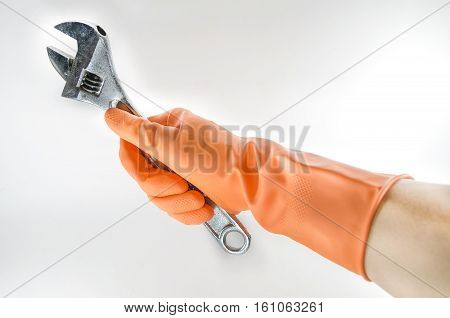 wrench in a orange glove on a white background