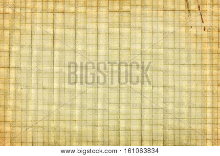 Old stained graph paper background with clip imprint