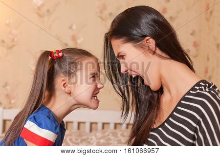 Mother and daughter make each other terrible faces
